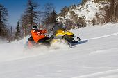 stock photo of ural mountains  - Athlete on a snowmobile moving in the winter forest in the mountains of the Southern Urals - JPG