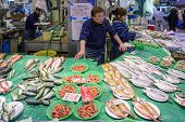 A fish vendor in Omicho Market in Kanazawa, Japan
