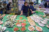 A fish vendor in Omicho Market in Kanazawa, Japan