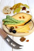 Cheese Platter: Solid Cheese, Olives, Walnuts And Autumn Leaves