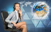 Businesswoman in headset, Globe and networks beside