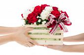 foto of gift basket  - Hand delivers baskets of red and white rose flowers as a gift isolated on white background - JPG