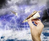 Hand Starts The Planes Of The Bills In The Stormy Sky