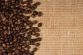 Coffee Beans Scattered On Burlap Can Be Used As Background