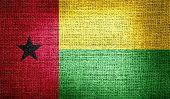 Guinea-Bissau flag on burlap fabric