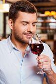 Enjoying Wine In Restaurant.