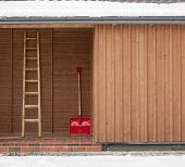 Red shovel and ladder