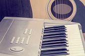 Digital Midi Keyboard And Acoustic Guitar.