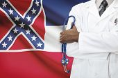 Concept Of National Healthcare System - Mississippi flag on background