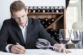 Winemaker Examining A Wine Glass.