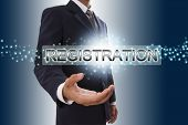 Businessman hand showing registration button