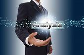 Businessman hand showing analysis button