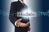Businessman hand showing update button