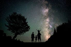 picture of boys night out  - Happy family silhouette with Milky Way and beautiful night sky full of stars in background - JPG