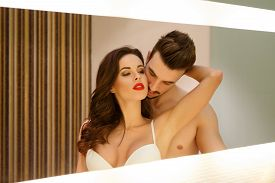 picture of hot couple  - Passionate sensual couple in mirror foreplay and desire - JPG