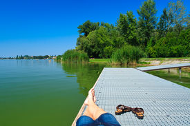 picture of tatas  - legs over the green lake in Tata - JPG