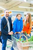 picture of grocery cart  - Family with shopping cart in grocery store - JPG