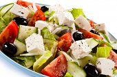 foto of greeks  - Greek salad on white background - JPG