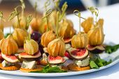 stock photo of canapes  - Canapes with physalis fig cheese and crackers - JPG