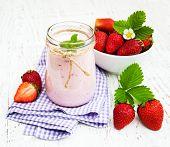 stock photo of strawberry  - Strawberry yogurt with fresh strawberries on a wooden background - JPG