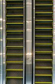 image of escalator  - Looking down at multiple escalators in an office building
