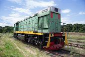 image of locomotive  - Old locomotive moving along the railway line - JPG