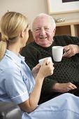 picture of visitation  - Nurse visiting senior man at home - JPG