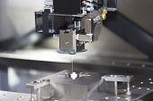 foto of machine  - CNC wire cut machine cutting high precision mold parts - JPG