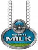 image of milk  - Metallic sign with text Fresh milk steel cans for the transport of milk and a green grass - JPG