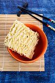 pic of briquette  - Background of briquette dry noodles Oriental type - JPG