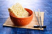 image of briquette  - Background of briquette dry noodles Oriental type - JPG