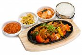 stock photo of pot roast  - Roasted meat with vegetables in a skillet with rice and spicy salad - JPG
