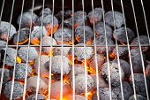 image of briquette  - Burning grill briquettes with clear empty grid - JPG