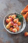 pic of ceramic bowl  - High angle view of fresh sweet apricots in ceramics bowl on a rustic stone surface - JPG