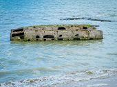 foto of mulberry  - Ruins of artificial harbor Mulberry built by the Allies in Arromanches Normandy France before the Debarquement of the D - JPG