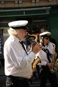 Man Playing Clarinet At Street Festival
