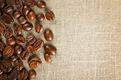 foto of sackcloth  - Frame of coffee beans on color sackcloth background - JPG