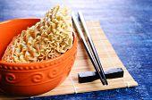 stock photo of briquette  - Background of briquette dry noodles Oriental type - JPG