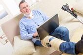 stock photo of crutch  - Man with leg in neck brace - JPG