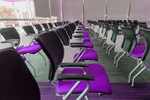 stock photo of training room  - Many purple chairs arranged neatly in a training room - JPG
