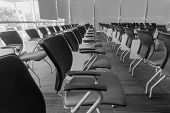 image of training room  - Many chairs arranged neatly in a training room made with black and white color - JPG