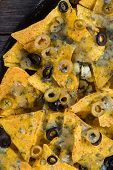 stock photo of nachos  - mexican hot street food nachos with salsa dip from above - JPG