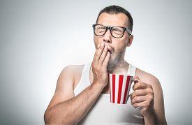 image of nerds  - Funny sleepy man with cup coffee yawn - JPG