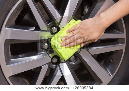 poster of A woman hand with yellow microfiber cloth cleaning big max car, car concept, car idea, car housework, car cleaning , car washer.