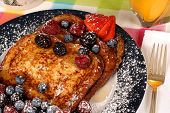 stock photo of french toast  - plate of french toast with fruit and maple syrup closeup - JPG