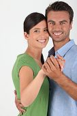 Portrait of a couple dancing on white background