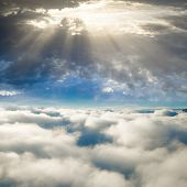 God's heaven shines over sky clouds