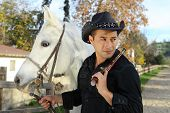 Cowboy With White Horse And pistol