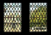 picture of stained glass  - The view through two stained glass windows in the landmark Bruges Town Hall - JPG