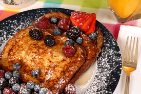 picture of french toast  - plate of french toast with fruit and maple syrup closeup - JPG